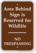Area Behind Sign Is Reserved No Trespassing Sign